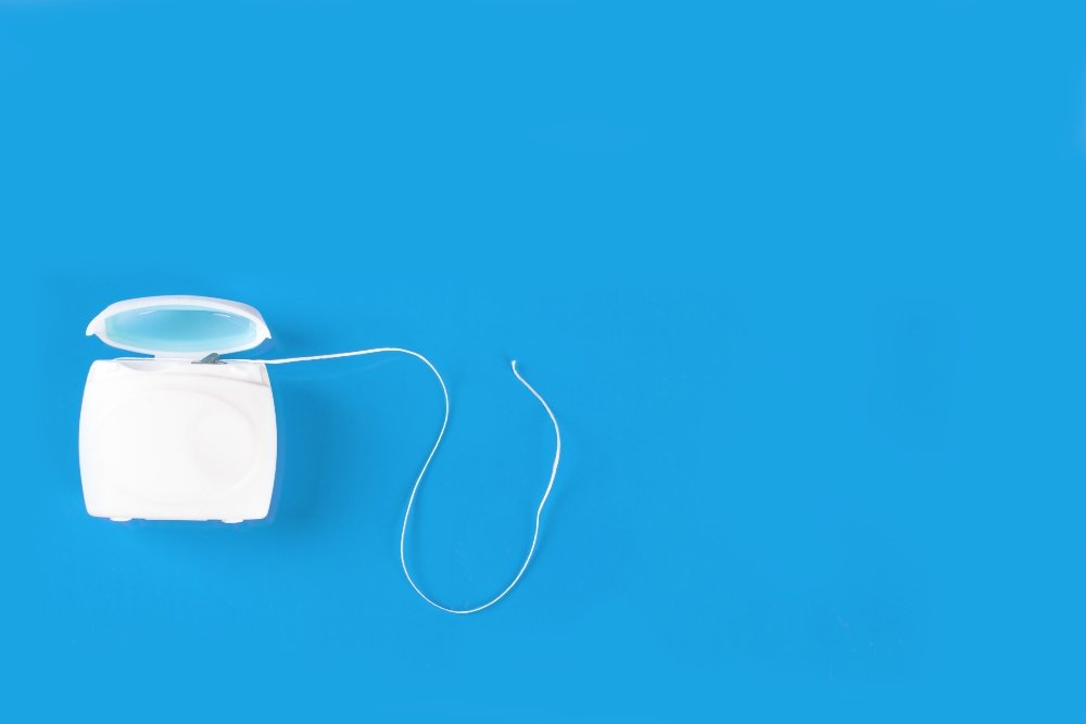Dental floss promotional products