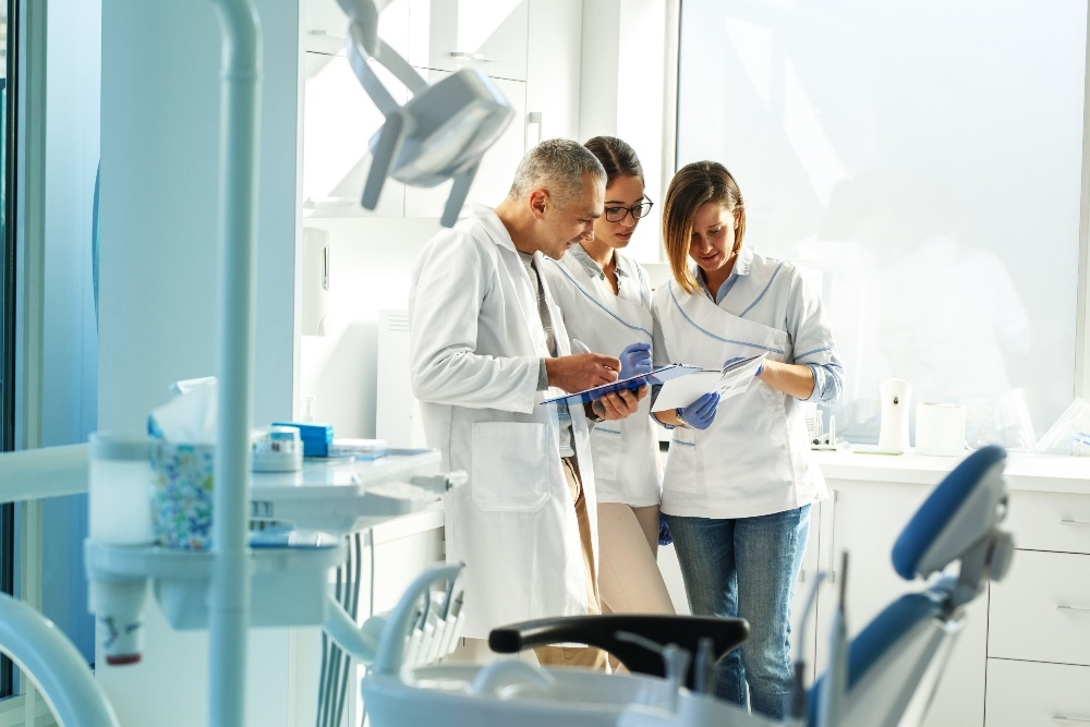 Dentists reviewing paper work